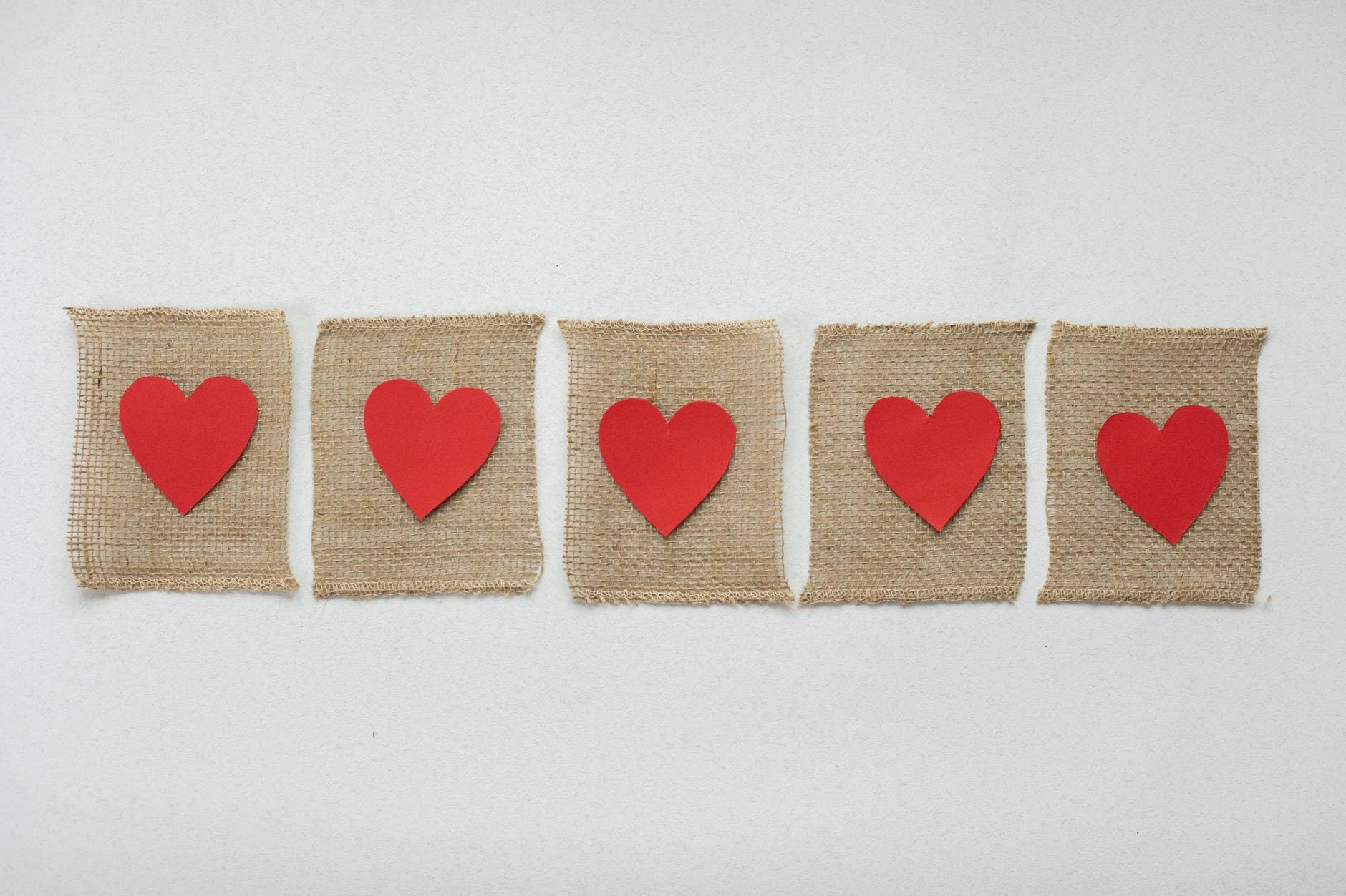 pieces of fabric with red hearts